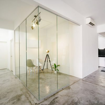 Modern,bright,clean,living ,study room and kitchen interior with glass partition in a loft style house , Interior photography.
