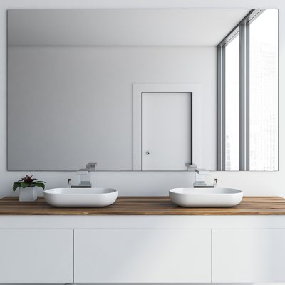 Close up of double bathroom sink standing on white and wooden countertop in room with white walls and large mirror. 3d rendering