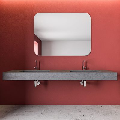 Interior of spacious spa bathroom with red and pink tile walls, concrete floor, stone double sink and horizontal mirror above it. 3d rendering